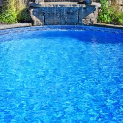 inground-residential-swimming-pool-with-waterfall